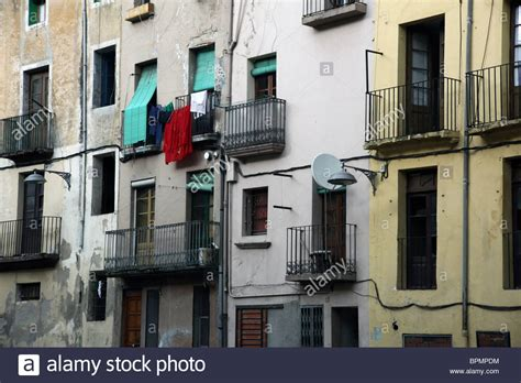 A block of poor houses and flats street scene from Olot in