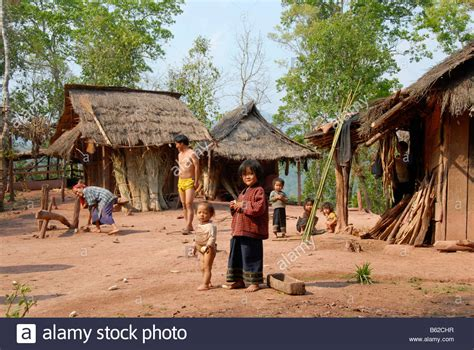 Poverty, children in a village, simple huts, Xieng Khuang